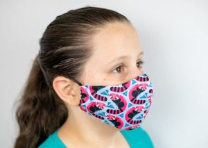 Girl wearing an eco-friendly face mask.