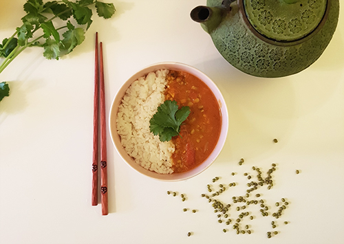 Bowl of vegan dish with mung beans soupe and rice.