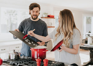 Couple cooking a meal at home.