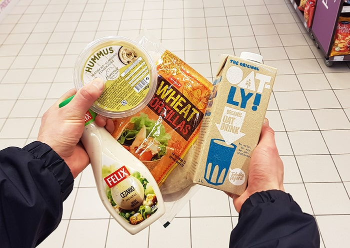 Hands holding processed food that can be made at home.