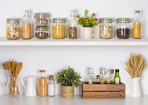 Sustainable pantry shelf with mason jars and food ingredients.