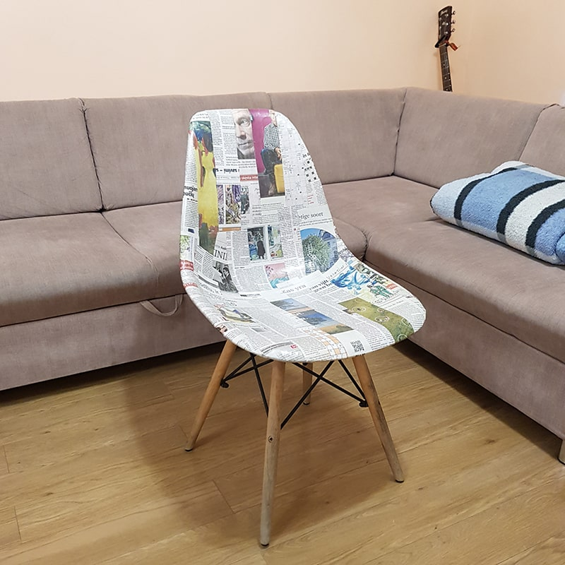 Chair upcycled with newspaper.