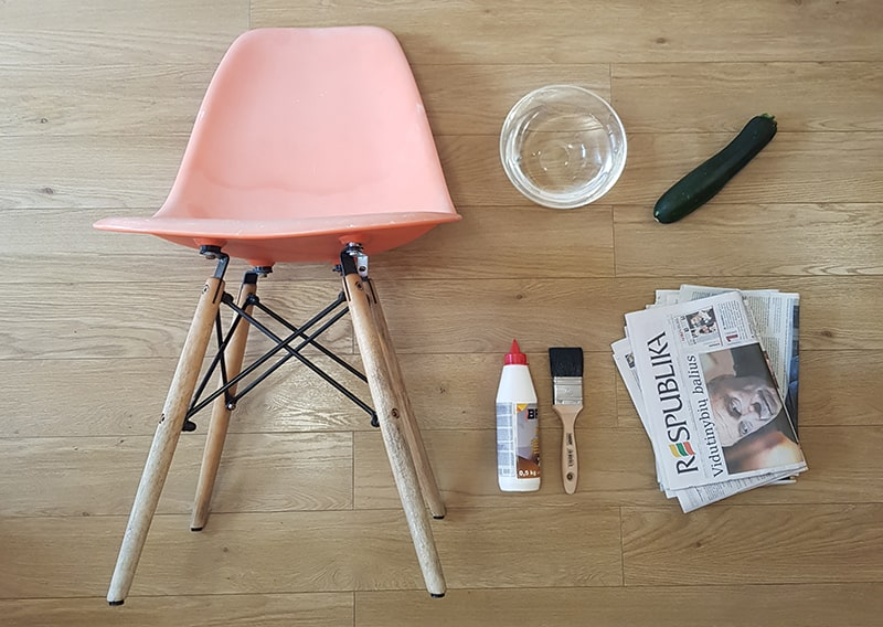 Old chair with tools to make a craft.