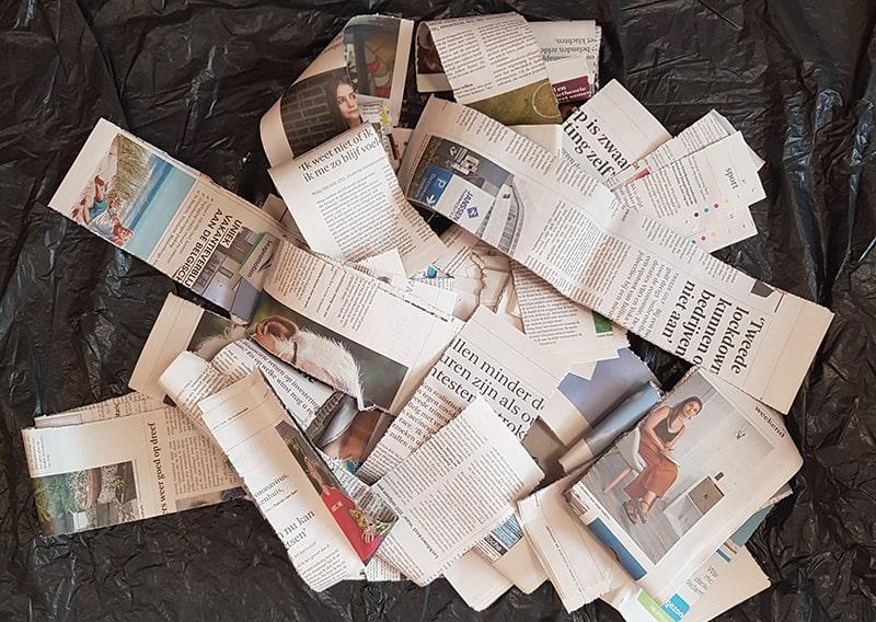 Strips of a reused newspaper.