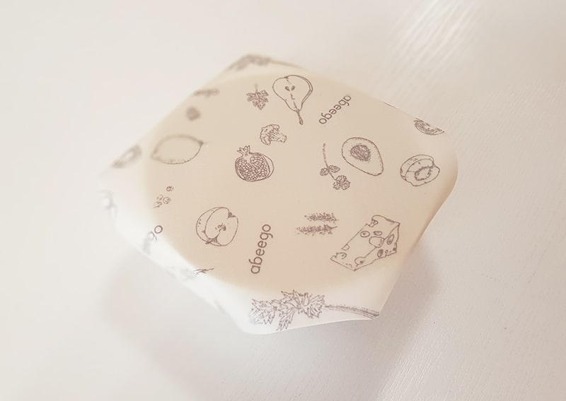 Small bowl covered with beeswax wrap.