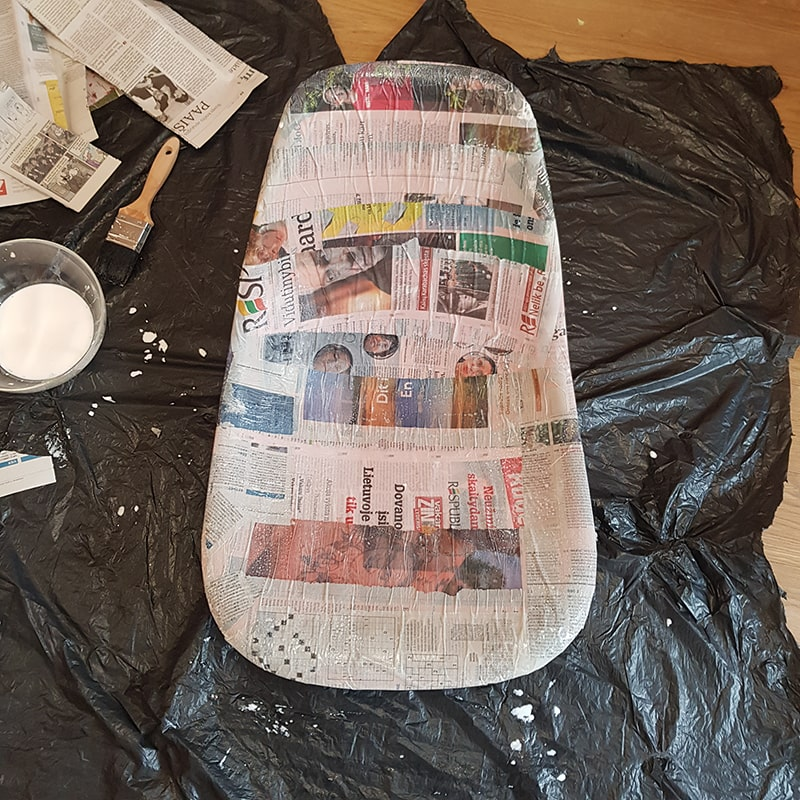 Chair freshly covered of newspaper strips with glue.