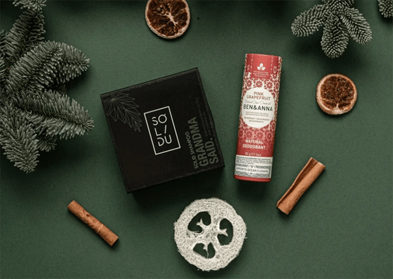 Dry shampoo and package-free deodorant with christmas decoration.
