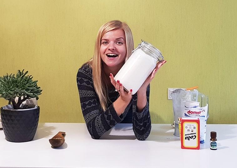 Girl holding a mason jar full of home-mode laundry soap.
